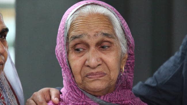 Krishnabevi Alisher, the mother of Manmeet Alisher, outside court.