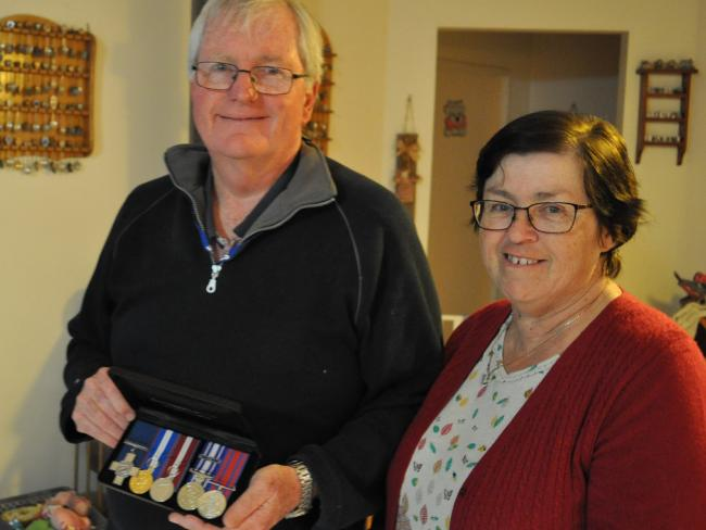 Michael Pratt and wife Dianne with his George Cross for bravery.