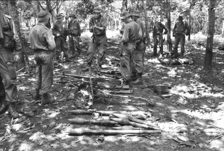 Australian soldiers gathering Vietnamese equipment after the Battle of Long Tan.