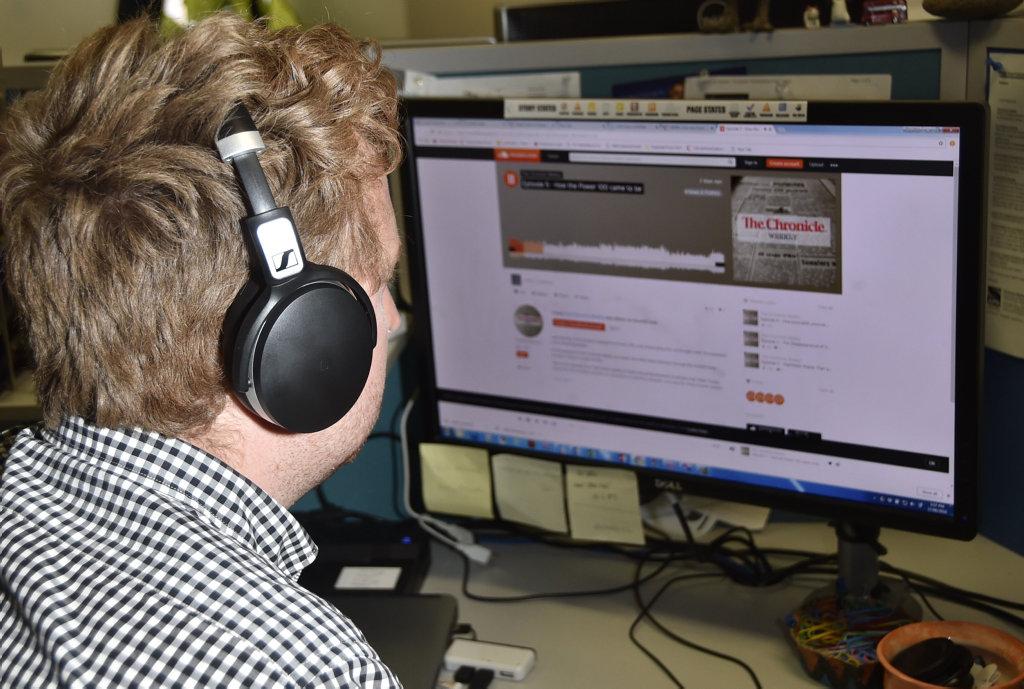 Journalist Tobi Loftus, listening to podcast. August 2018