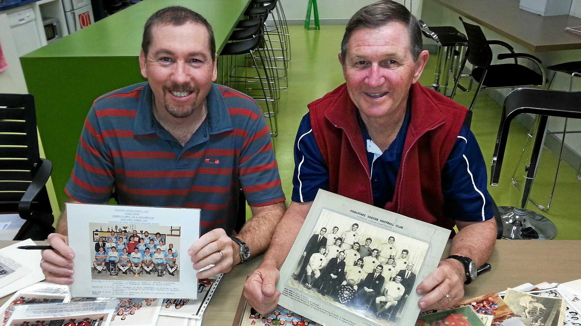 Ipswich football researcher Ross Hallett (right) with another stalwart Garth Mitchell. Hallett is eager for more memorabilia to complete an exciting Ipswich football history project.