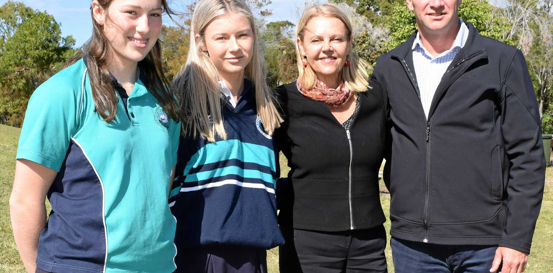 GOING UP: Sunshine Beach High principal Paul Fitzgerald with students Courtney Steel and Stephanie Welsh show MP Sandy Bolton the site of the new classrooms.