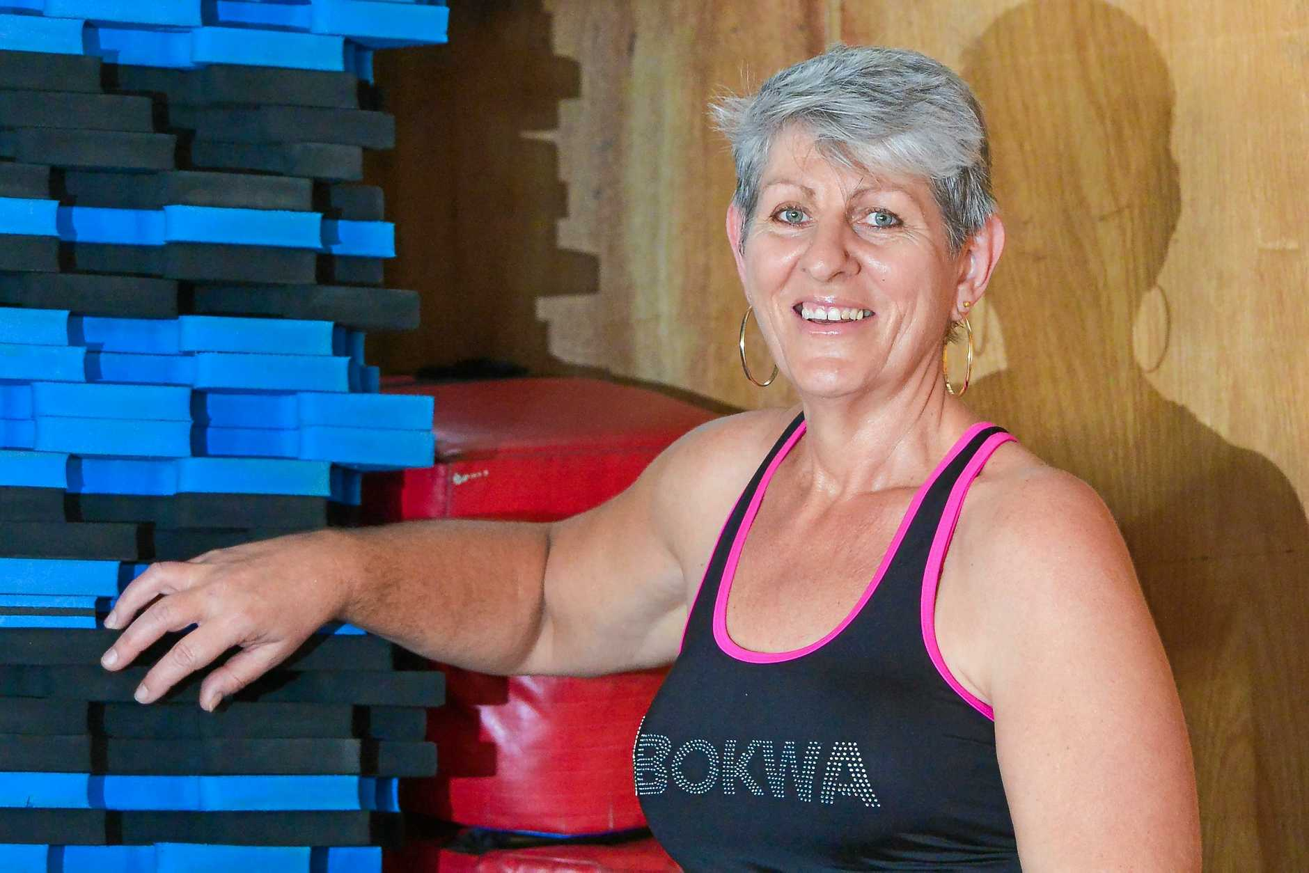 WAKE-UP CALL: Breast cancer survivor Catherine Hayter has lost a significant amount of weight  and now teaches the fitness class she says changed her life, Bokwa.