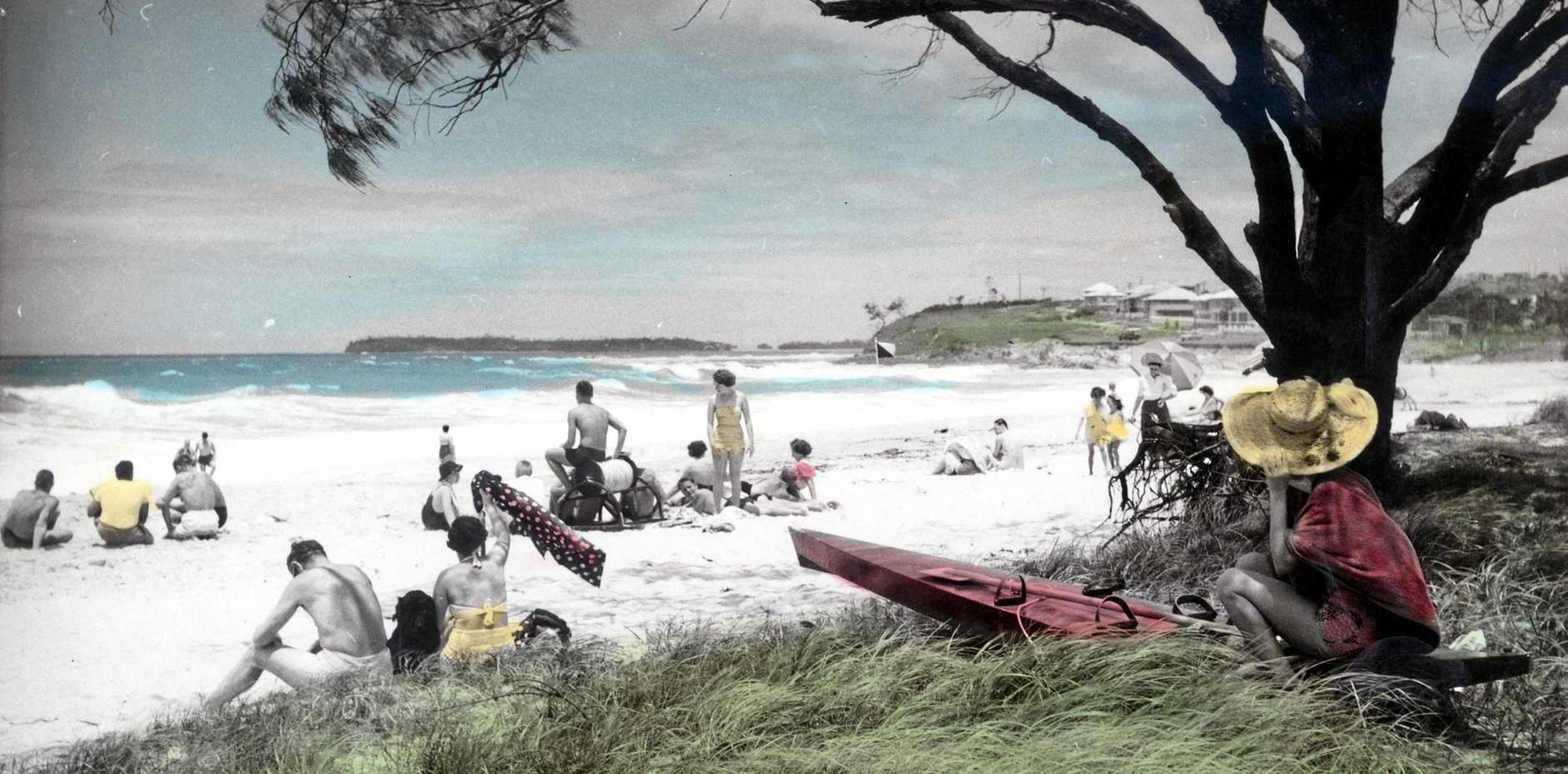EVER POPULAR: Holiday-makers on the beach at Alexandra Headland, late 1950s.