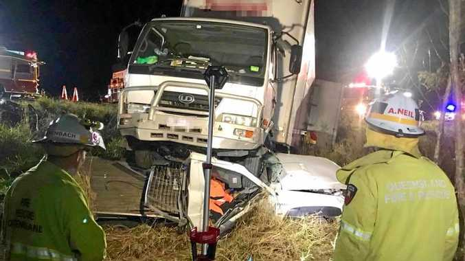 A truck rolled onto a 4x4 off the Bruce Highway, pinning it to the ground at Beerwah. Somehow no one was hurt.