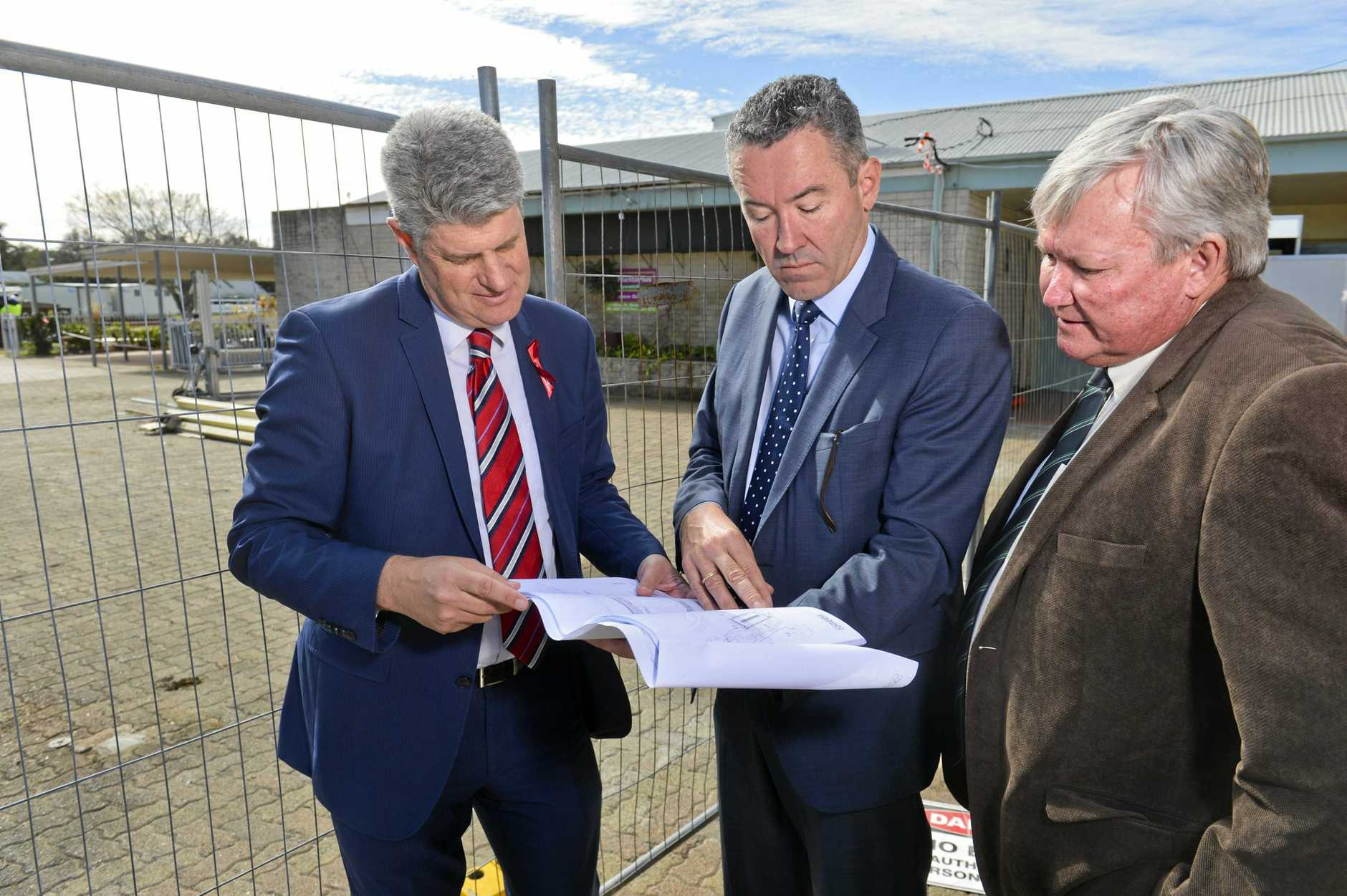 Racing Minister Stirling Hinchliffe, Racing Queensland CEO Brendan Parnell and Ipswich Turf Club chairman Wayne Patch look over major redevelopment plans for the Ipswich Turf Club.