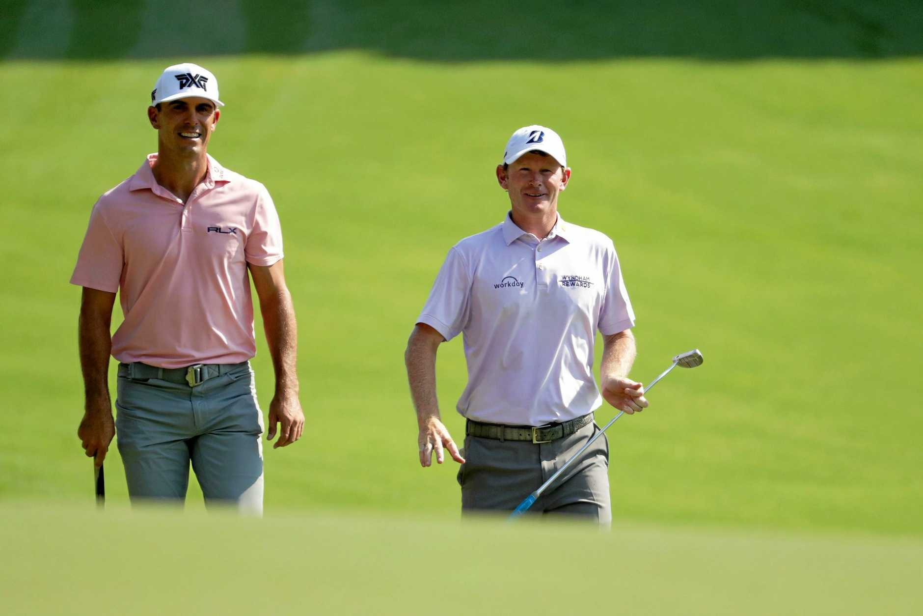 GREENSBORO, NC - AUGUST 16:  Brandt Snedeker(R) and Billy Horschel walk the first fairway during the first round of the Wyndham Championship at Sedgefield Country Club on August 16, 2018 in Greensboro, North Carolina.  (Photo by Streeter Lecka/Getty Images)