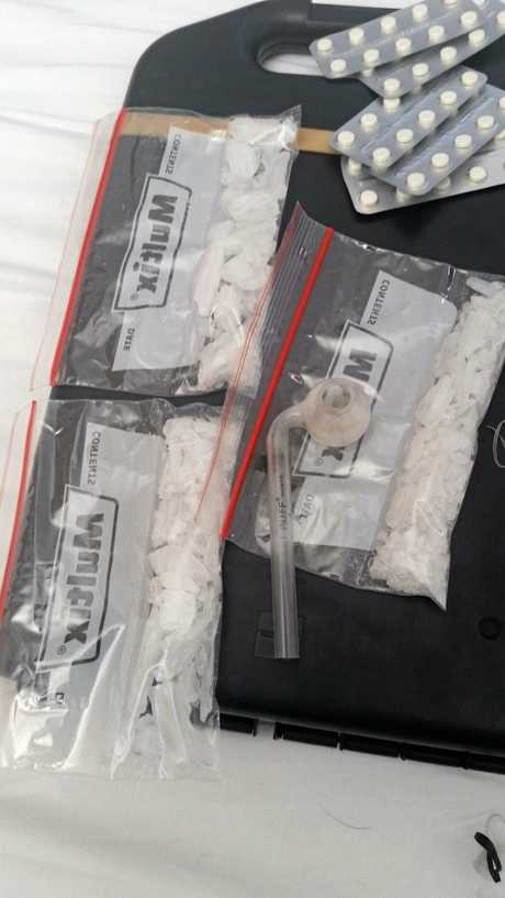 DRUG BUST: Drugs and cash seized by police attached to the Maryborough CIB on Thursday. A 33-year-old man and 25-year-old woman will face court over the bust.