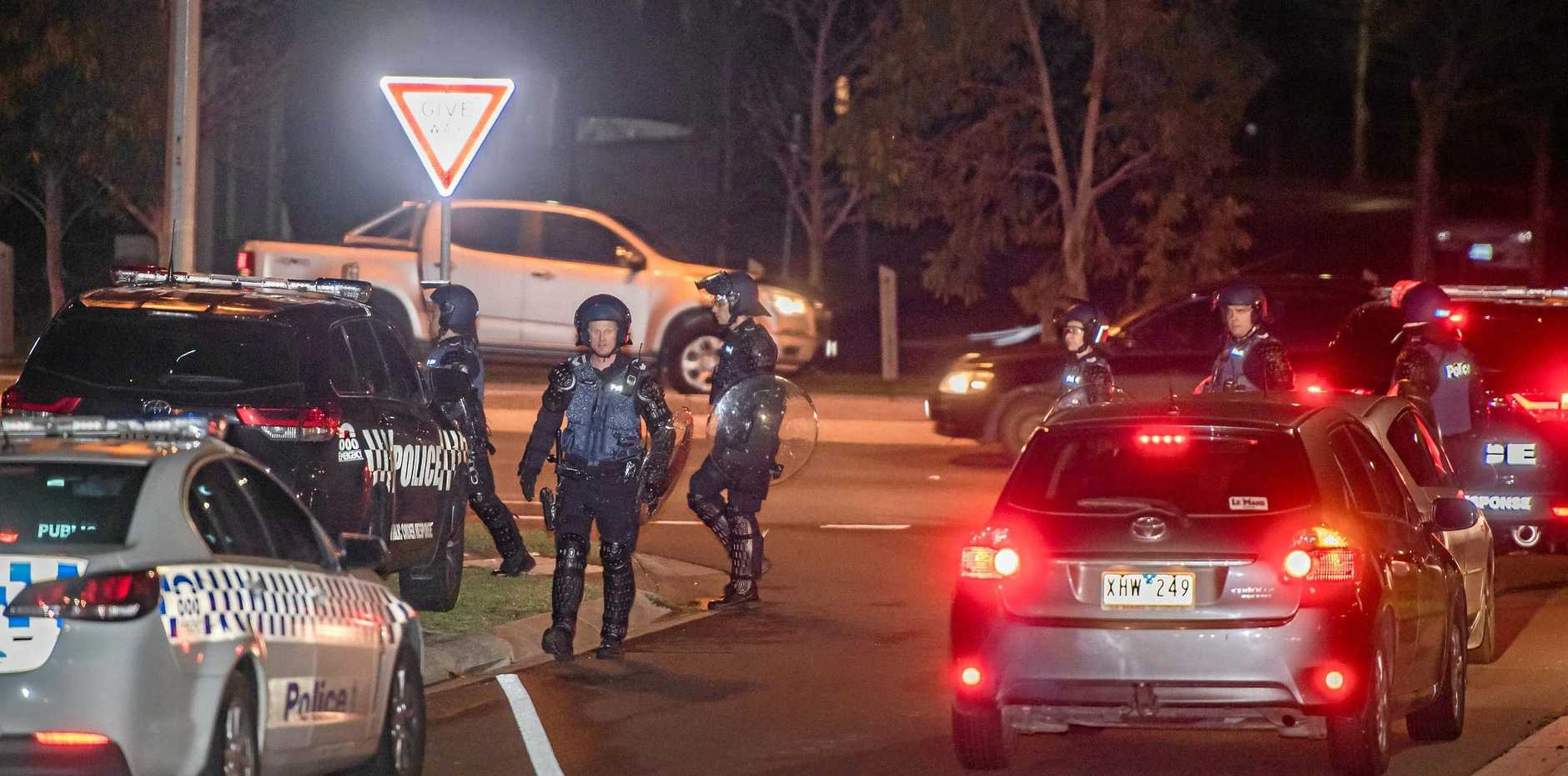 POLICE PRESENCE: Dozens of police, including some in riot gear, gather in Taylors Hill, Melbourne, after a large group of youths wreaked havoc in the area.