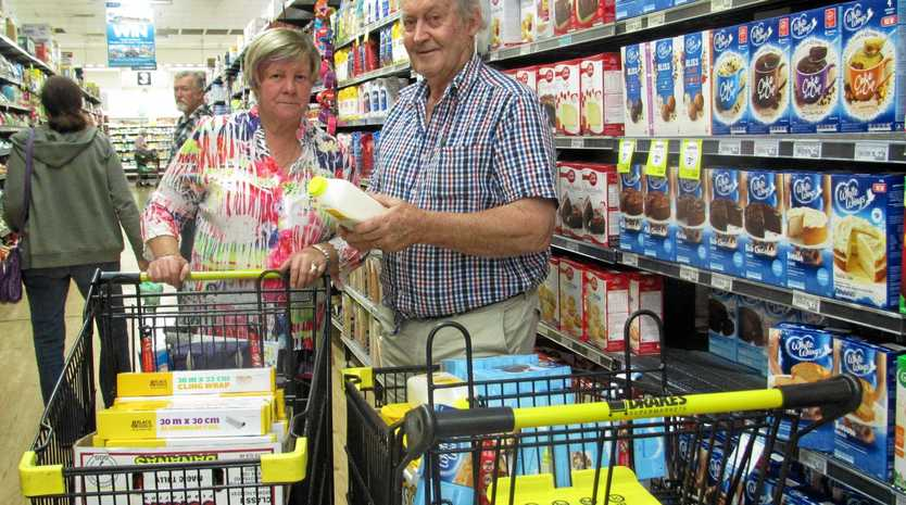 COUNTRY COMFORT: Marlene Owen and Tony Stewart stock up for their next delivery to drought-hit outback Queensland.