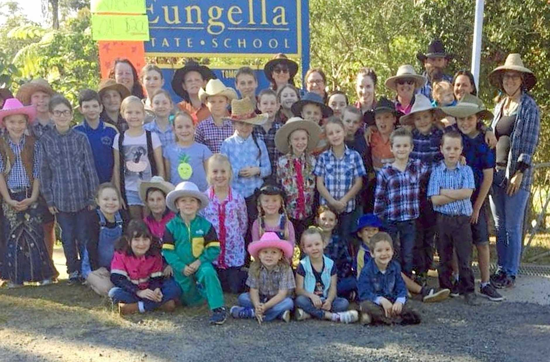 Eungella State School students dressed as farmers on Thursday and raised $400 for the Buy a Buy of Hay campaign to assist farmers in drought.