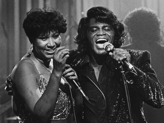 Aretha Franklin with fellow soul legend James Brown in 1987.