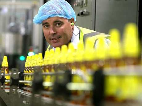 Capilano CEO Ben McKee on the honey filling line, at the company's production plant in Richlands, Brisbane.