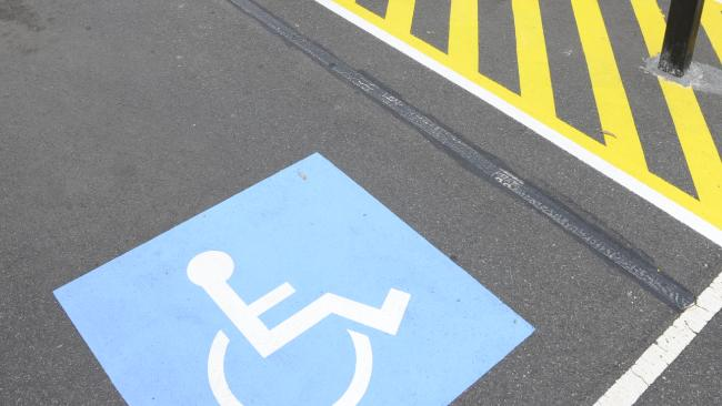 Transport Minister Mark Bailey will look at introducing tougher penalties for motorists who illegally use disability car spaces