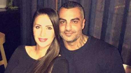 Hawi with wife Carolina Gonzalez.