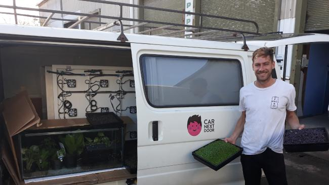 Melbourne 'urban farmer' Thomas Paterson with his van.