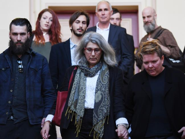 Hannah Quinn's mother Megan (centre), father Dean Hintz (back, centre), brothers Dominic and Elliot and LGBTIQ supporter, bottom right, at Newtown Court. Picture: Dean Lewins