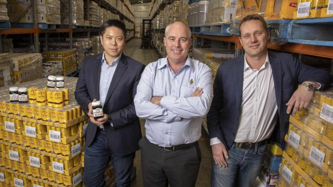 Wattle Hill's Albert Tse (left), Capilano CEO Ben McKee and Roc Partners' Mike Lukin at the Capilano Honey factory in Brisbane.