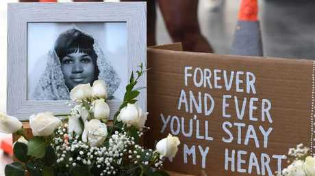 Flowers and tributes are placed on the Star for Aretha Franklin on the Hollywood Walk of Fame in Hollywood, California. Picture: AFP