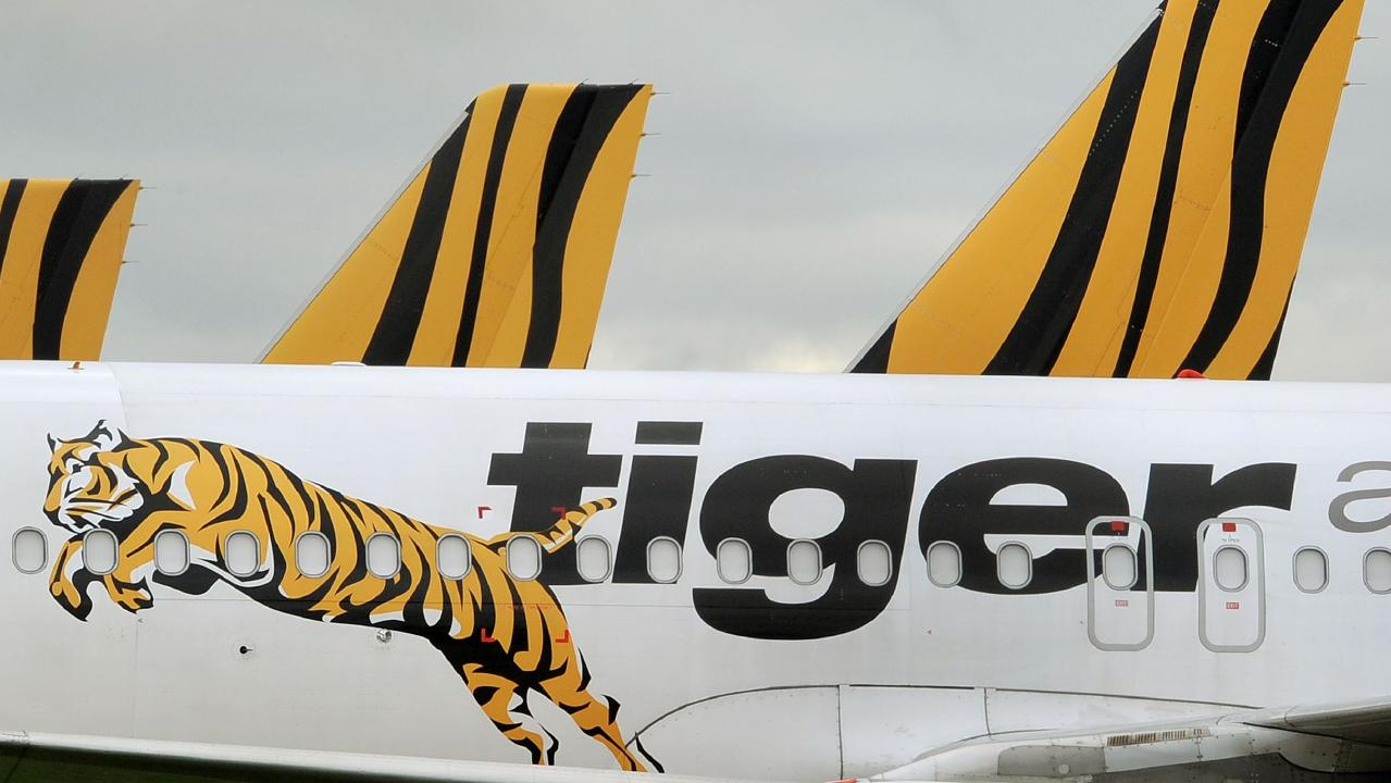 A Melbourne family claims Tiger Airways suggested it could try to make a claim on travel insurance for costs incurred after a cancelled flight but would get no compensation from the airline AFP PHOTO/William WEST