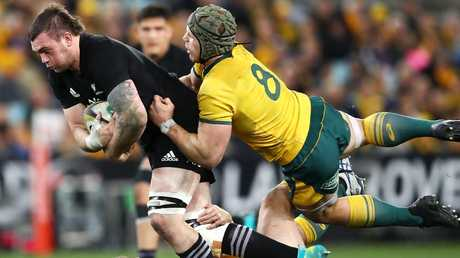 It was another big effort from David Pocock, here bringing down Liam Squire of the All Blacks (Photo by Mark Kolbe/Getty Images)