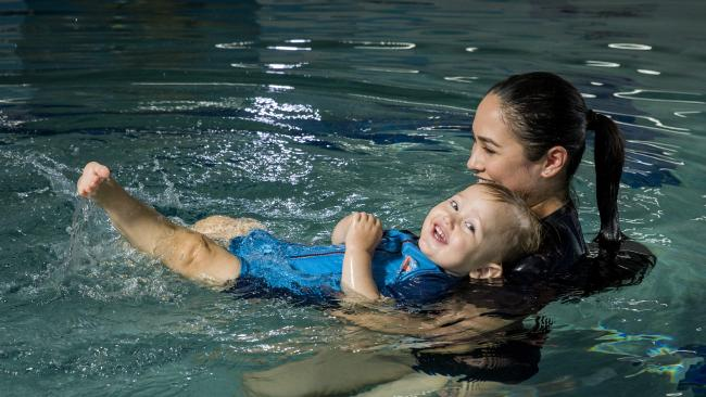 18-month-old Axel with mum Karina Elcock at Andrew Baildon's SUPERFISH Swim Schools in Sunnybank. Photo: AAP Image/Richard Walker