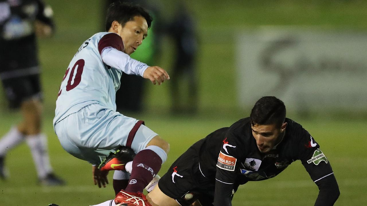 Tasuku Sekiya (left) scored a goal in each half as APIA Leichhardt defeated Melbourne Victory in the FFA Cup.