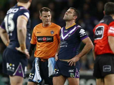 Cameron Smith receives medical help during yesterday's game.