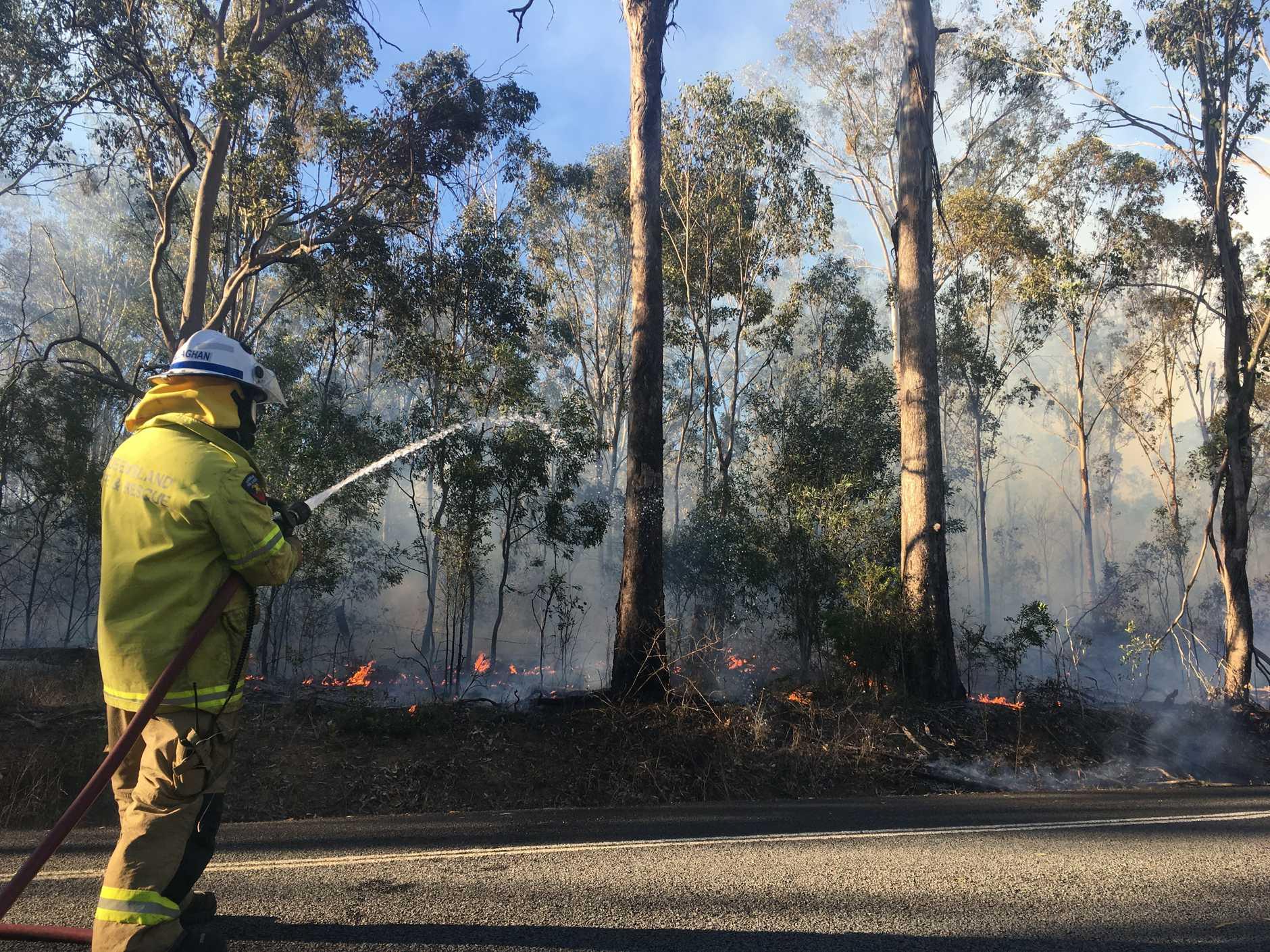 Crews are still on scene containing a grass fire in Nanango.