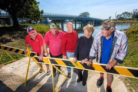 Tony Berry, John hoy, President Rick Reid, Lyn Morgan and Rick Morgan look over the closed Sportsman Creek boat ramp.
