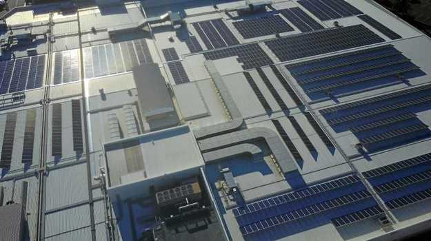 Drone shots of the solar panels installed on top of Park Beach Plaza.