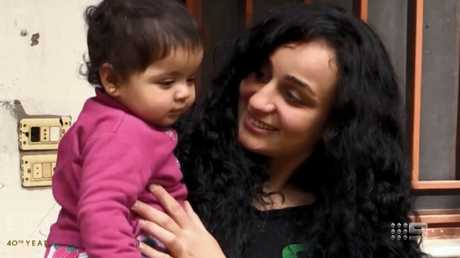 Islam Mitat with her daughter Maria who she had with her Australian husband in Syria. Picture: Channel 9.
