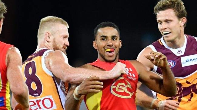Robertson (left) gets into Gold Coast's Touk Miller. Pic: AAP