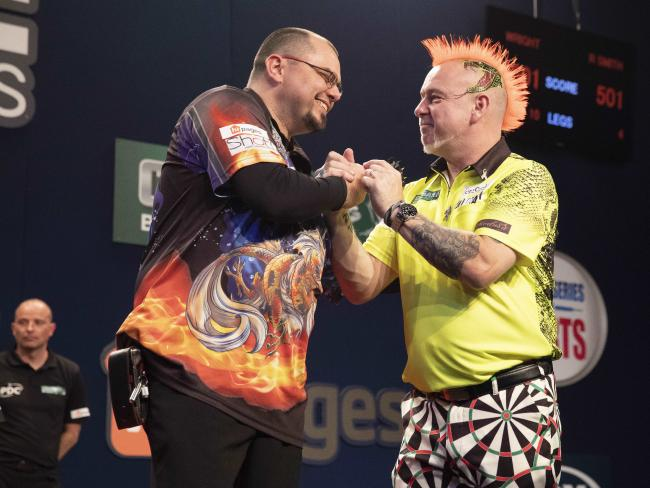 Raymond Smith (left) and Peter Wright at the Brisbane Darts Masters. Picture: Richard Walker/AAP