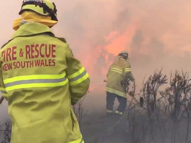 Fire crews battling the out-of-control bushfire at Salt Ash. Picture: Seven News