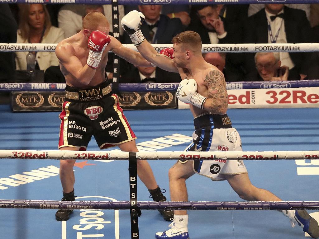 Carl Frampton on the attack against Luke Jackson. Picture: NIALL CARSON/PA VIA AP