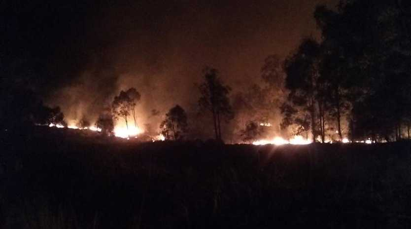 Crews are responding to a bushfire in Cooyar while the Teelah bushfire (pictured) continues to burn.