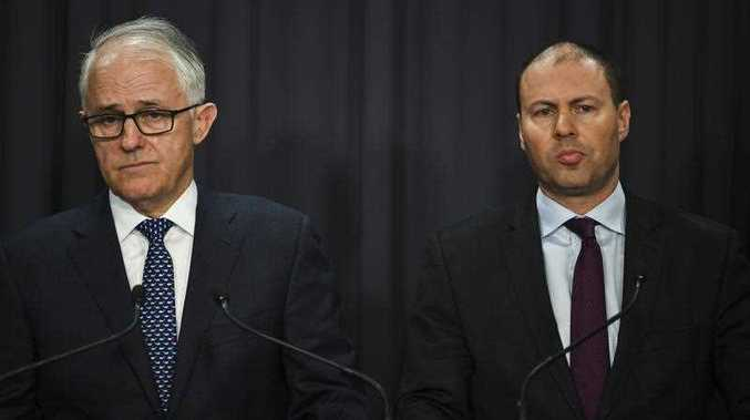 Australian Prime Minister Malcolm Turnbull and Australian Energy Minister Josh Frydenberg speak during a press conference at Parliament House in Canberra, Monday, August 20, 2018.