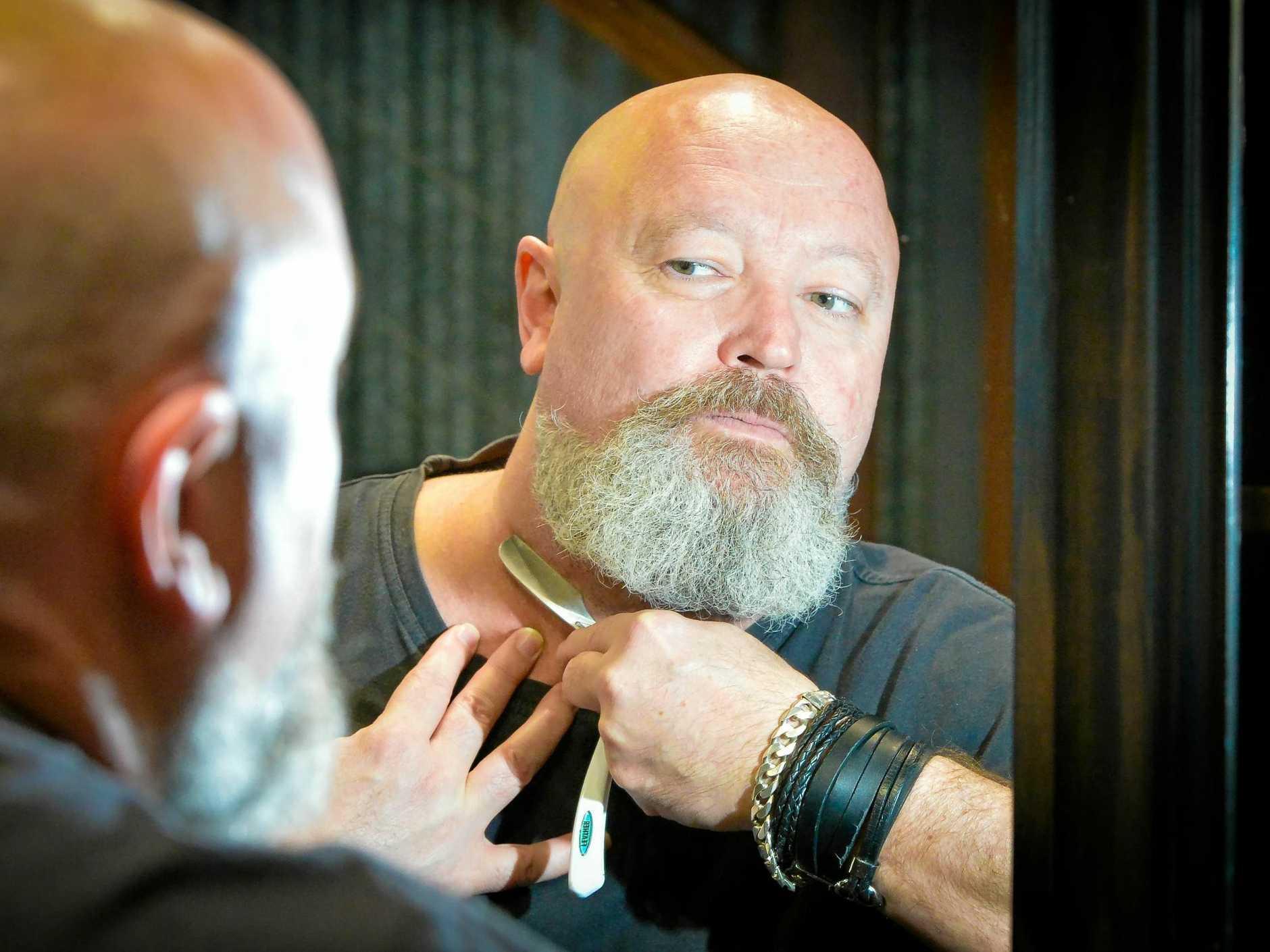 CUTTING EDGE: Rex Silver of The Garage Barber Shop