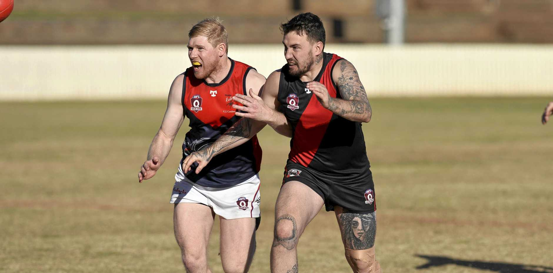 FIERCE CONTEST: Warwick Redbacks player Andrew Politch (left) and Kurt Heier of South Toowoomba Bombers jostle for position during the Redbacks 30-point victory at the weekend.