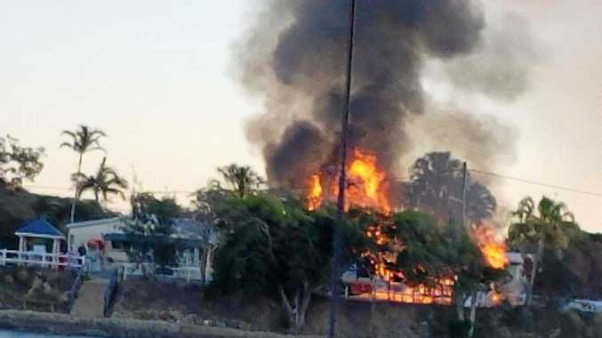 Fire crews battle a large fire that ripped through a house at Causeway Lake this morning.