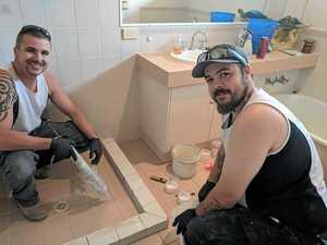 EXPANDINGL Aquashield Bathrooms director Chris Rewers and Leading hand Zep Wheatley.