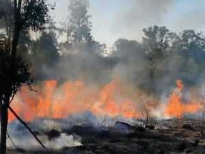 Backyard blaze next to Bruce Hwy sparks concern