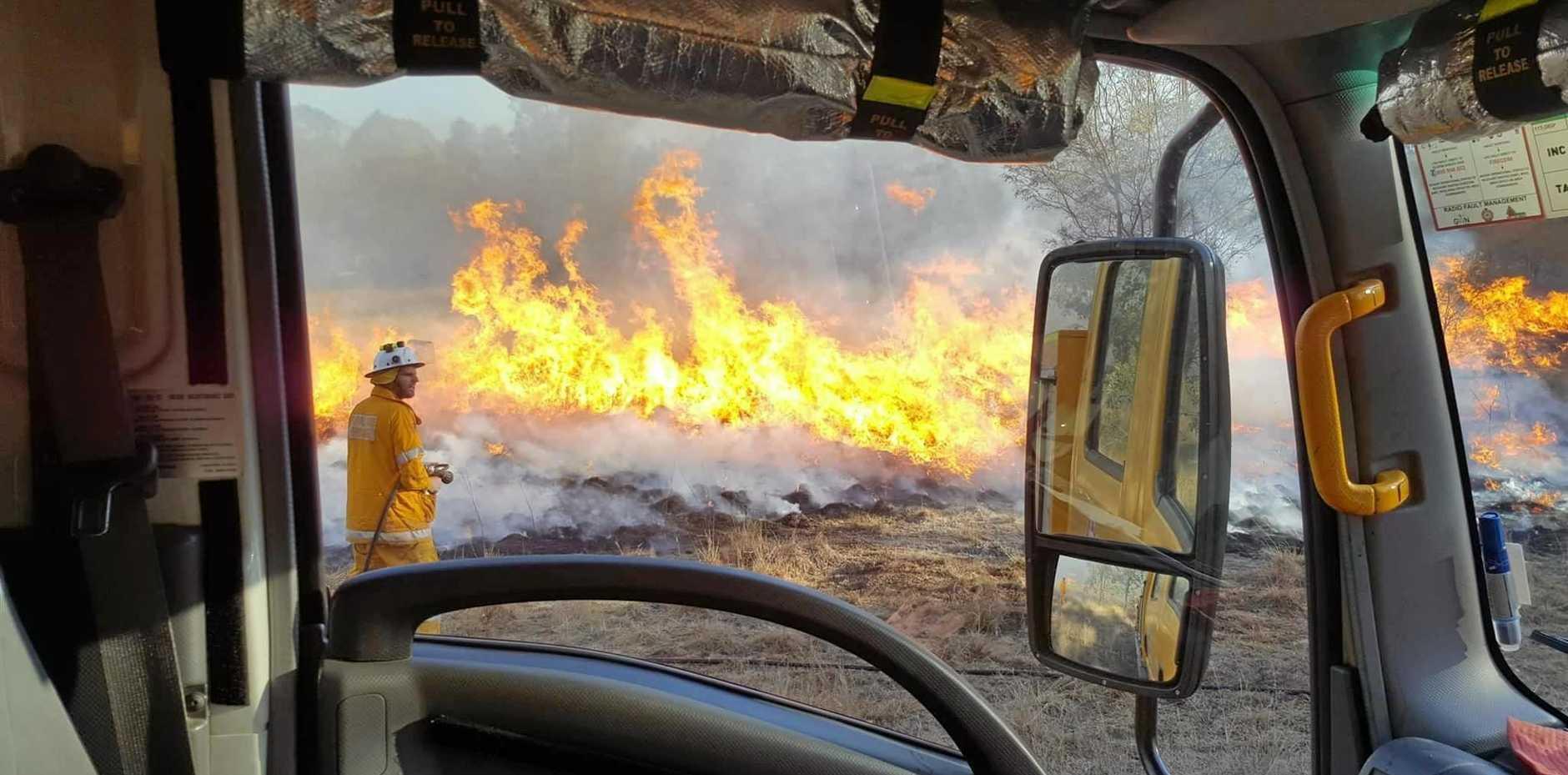 FAST-MOVING: Gowrie Little Plain Rural Fire Brigade Rural Fire Service crews battle a fast-moving bushfire at Cooyar.