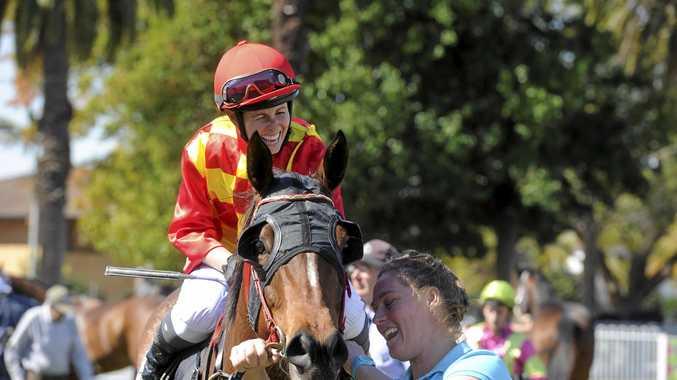 LATE DASH: Kasie Stanley celebrates   on board winner Vivid Image at the Clarence River Jockey Club.