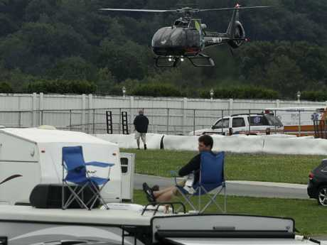 Wickens is airlifted to hospital by a medical helicopter. Picture: AP