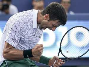Federer flops as Djokovic makes history
