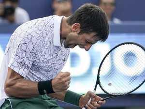 Federer flops as Djokovic makes history