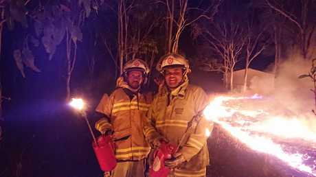 Cherbourg crew attending to a small grass fire near the Tafe. Geno Barrett and Charlie Bond putting in a back burn to make area safer.