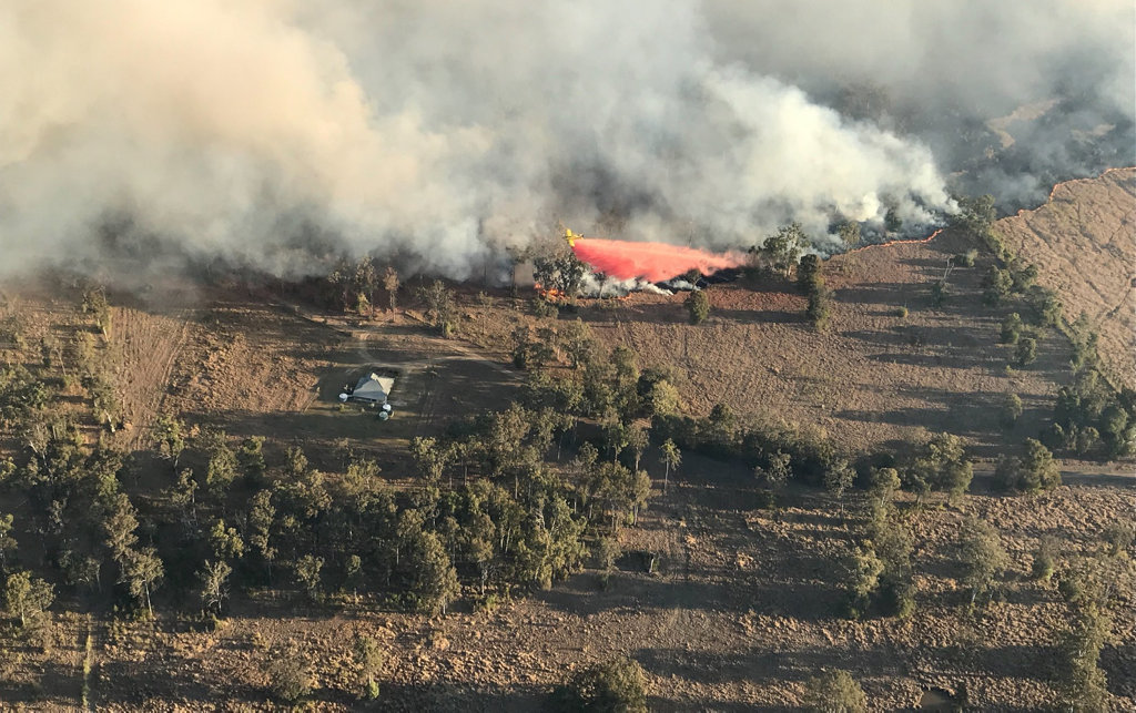 Aircraft have been dropping fire retardant on the bushfire on Mothersoles Rd, Ellangowan.